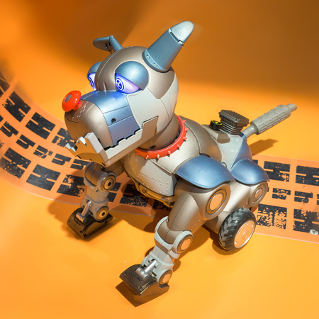 wagging: Toy robot dog wagging the tail Stock Photo