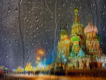 st  basil: Night view of illuminated St. Basil Cathedral at Moscow, in a rainy day throug wet window glass
