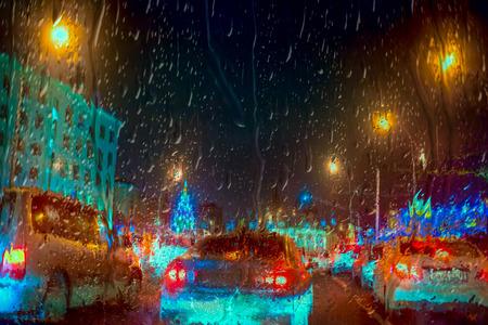 stoplights: Inside the car - night rain and town lights Stock Photo