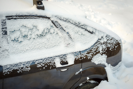 space weather tire: Snow covered car after snowfall Stock Photo
