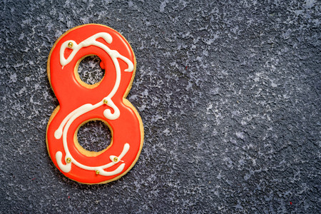 bake sale sign: Tea cookie number eight on a dark grey background with copy space