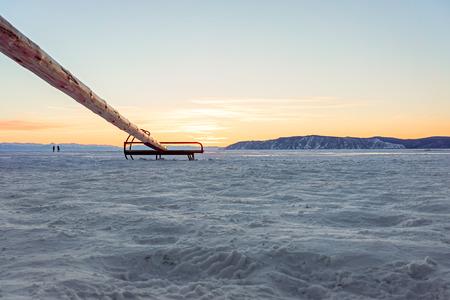 icy: wooden sledge on icy Baikal lake