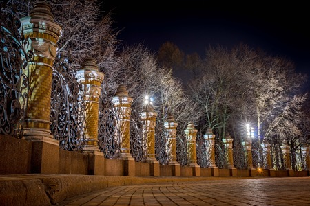 ST: Night view of the fence of the Mikhailovsky Garden in the temple of Savior on Spilled Blood, St.Petersburg, Russia Stock Photo