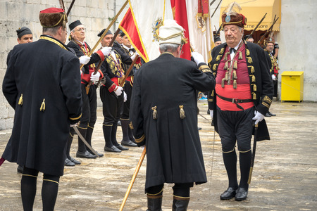 commander: Perast, Montenegro - May 15, 2016: Shooting the Kokot (rooster) celebration. Celebrates the liberation of Perast from Turkish in 1654. Supreme Commander takes military parade.