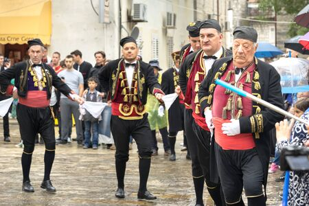 hankerchief: Perast, Montenegro - May 15, 2016: Shooting the Kokot (rooster) celebration. Celebrates the liberation of Perast from Turkish in 1654. Theatrical performance on a city street. Dance with hankerchief.