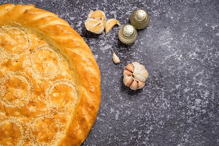 pastil: Hot Tasty bread cake with garlic and salt and black pepper with copy space Stock Photo