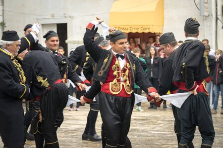 Perast, Montenegro - May 15, 2016: Shooting the Kokot (rooster) celebration. Celebrates the liberation of Perast from Turkish in 1654. Theatrical performance on a city street. Dance with hankerchief.