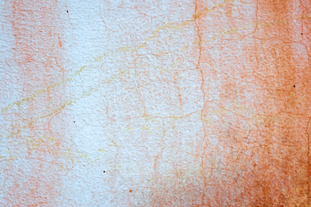 heterogeneous: putty cracked red and white wall background texture