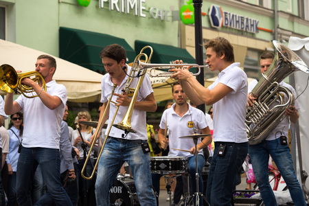 prodigious: Moscow, Russia - July 10, 2016: cover band Brevis Brass Band performance on a city street. It is unique Moscow cover team with prodigious energy, consisting of a cheerful young people.