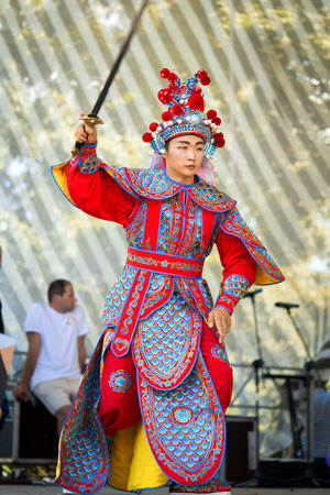 sword act: Moscow, Russia - July 31, 2016: the performance of the Chinese show Golden Dragon Drumpst in the open air during the celebration of the international tiger day in Moscow. Chinese warrior with sword. Editorial