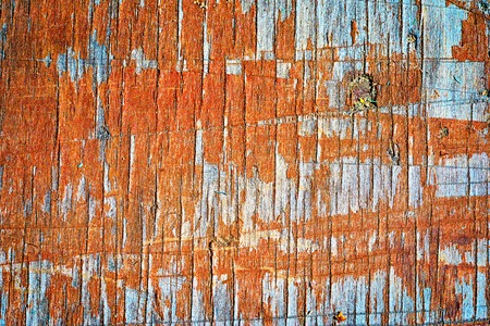 flaky: old wooden flaky orange painted board with lots of notchings, background