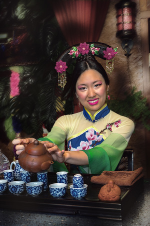 chinese tea ceremony: A young girl holds a Chinese tea ceremony