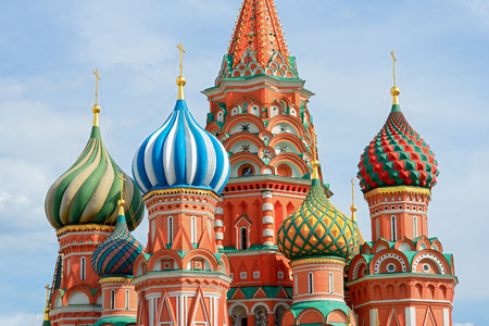 The most famous architectural place for visiting and attraction in Moscow, Russia, Saint Basils cathedral with colorful cupolas and spectacular domes in traditional culture on cloudy blue sky