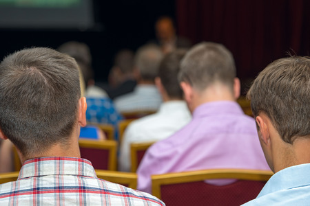 real leader: Close up rear view of a businessmen listening attentively to the speaker at the conference Stock Photo