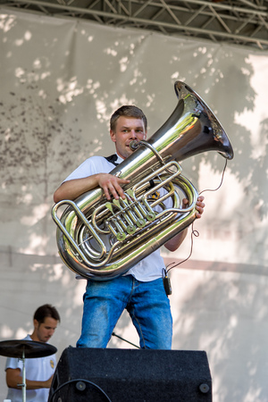 prodigious: Moscow, Russia - July 31, 2016: Cover band Brevis Brass Band performance on a city street. It is unique Moscow cover team with prodigious energy, consisting of a cheerful young people.: