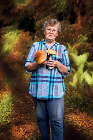 cepe: Caucasian happy active senior elderly woman holding cepe Stock Photo
