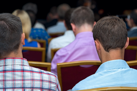 attentively: Close up rear view of a businessmen listening attentively to the speaker at the conference Stock Photo