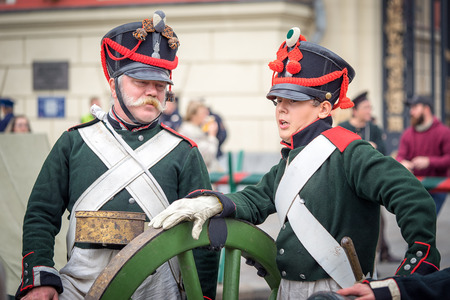 world war 1: Moscow, Russia - September 11, 2016: Moscow City Day. Moscow residents and guests celebrate the 869 anniversary of the city. Historical reconstruction - two soldiers in uniform of World War 1 era.
