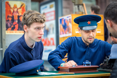 catechism: Moscow, Russia - September 11, 2016: Moscow City Day. Moscow residents and guests celebrate the 869 anniversary of the city. Performance on Tverskaya Street. Two men from KGB in a uniform. Editorial