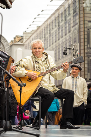 Moscow, Russia - September 11, 2016: Moscow City Day. Moscow residents and guests celebrate the 869 anniversary of the city. Performance on Tverskaya Street. Music band performs play balalaikas.