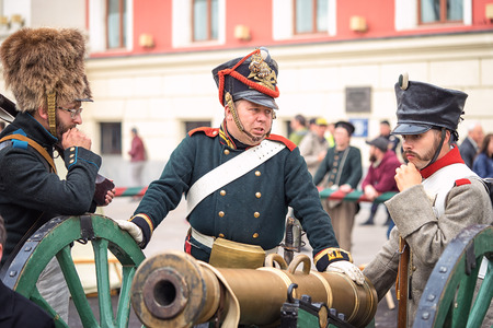 world war 1: Moscow, Russia - September 11, 2016: the celebration of 869 years of the city of Moscow. Historical reconstruction - three soldiers in uniform of World War 1 era. Concept of business meeting