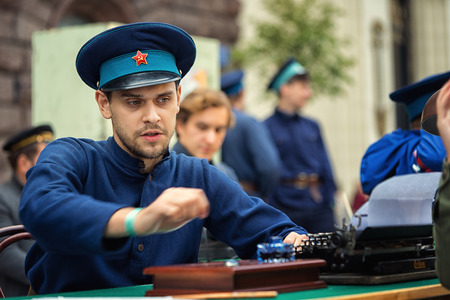 catechism: Russia, Moscow - September 10, 2016: Moscow City Day. Moscow residents and guests celebrate the 869 anniversary of the city. Performance on Tverskaya Street. Man from KGB in a uniform. Editorial