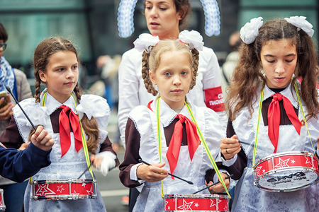 two party system: Russia, Moscow - September 11, 2016: Moscow City Day. Moscow residents and guests celebrate the 869 anniversary of the city. Performance on Tverskaya Street. Public-event. Pioneer drummer children.