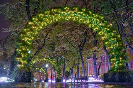 centenarian: Passion Boulevard, Moscow, Russia. Street decoration in the form of light arches. Stock Photo