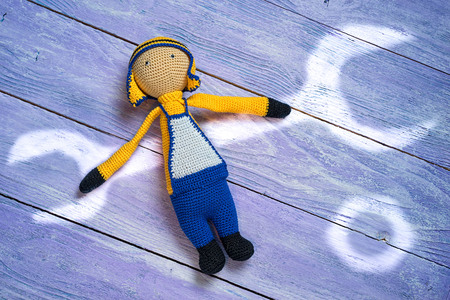 amigurumi crocheted worker with a painted light wrench and nut, repair concept Stock Photo