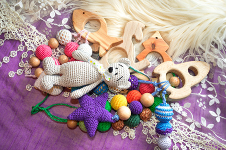 Pile of toys on a rug, lace and fur background