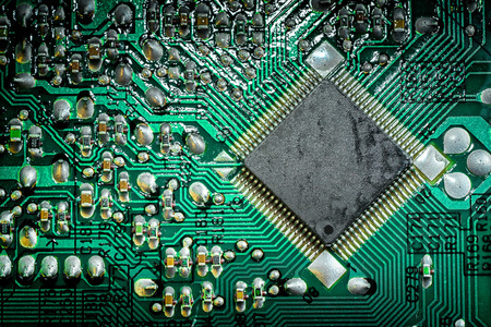 cmos: Close up of a printed green computer circuit board. electronics and IT manufacturing and business background Stock Photo