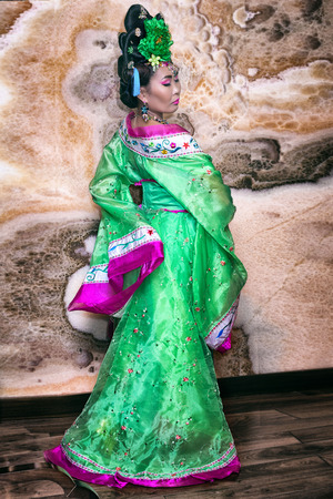 traditional clothes: Attractive young chinese woman in traditional clothes Stock Photo