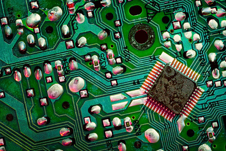 Close up of a printed green computer circuit board. electronics and IT manufacturing and business background Stock Photo
