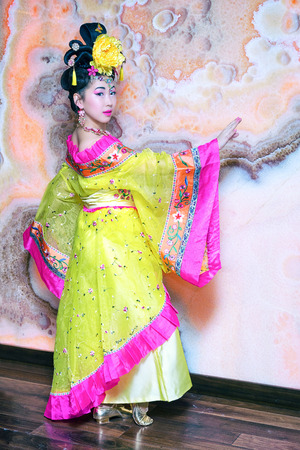 beautiful Chinese woman in traditional Chinese costume standing in half a turn