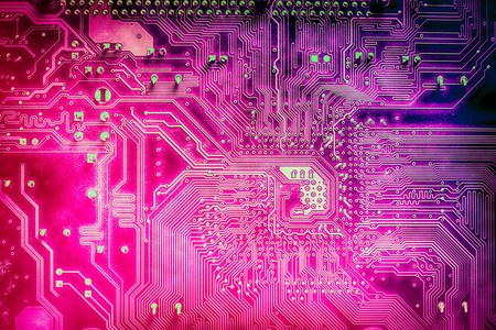 Macro shot of a circuit board, tinted in violet and blue shades