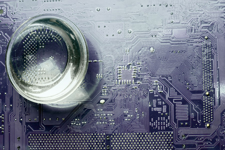 printed circuit: printed circuit board and magnifying glass Stock Photo