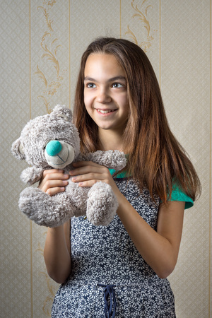11 year old: happy 11 year old girl with a teddy bear