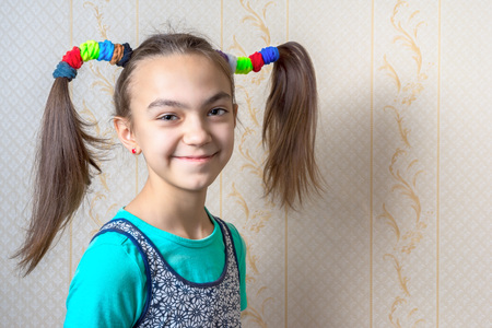 11 year old: portrait of a smiling 11 year old girl with funny tails in the style of Pippi Longstocking.