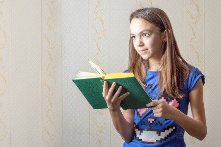 11 year old: 11 year old girl reading a book. Stock Photo