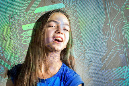 new generation: Portrait of a 11 year old girl with her mouth open through a circuit board silhouette. Concept of new generation, computer science and informatics lessons, cyber society. Stock Photo