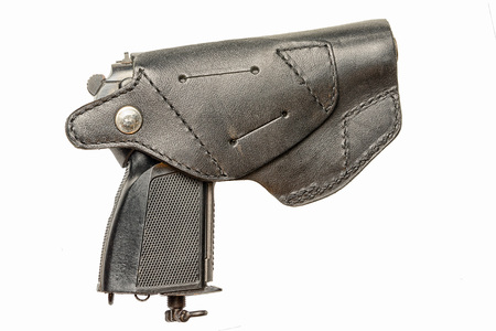 isoladed: pistol in a holster isolated on a white background