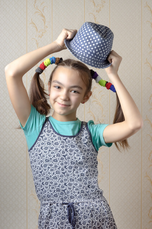 11 year old: Portrait of a 11 year old girl who wears a hat