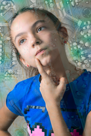 11 year old: close up portrait of 11 year old girl thoughtfully looking up, leaning a finger to her cheek, through the computer motherboard silhouette Stock Photo