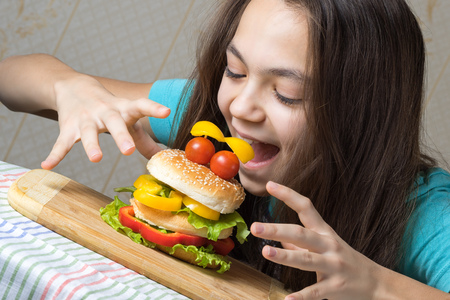 11 year old: Portrait of a 11 year old girl, a hamburger-eating as a smiley face with tomatoes eyes