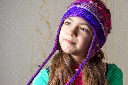 11 year old: Close up portrait of a 11 year old girl in a knitted cap
