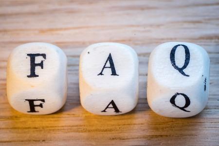 Word FAQ written with wooden cubes