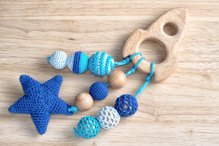 wooden spaceship toy with crocheted beads for toddler.