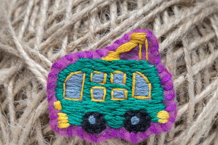 embroidered: homemade embroidered trolleybus on a thread ball