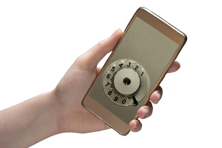 Hand holds mobile phone isolated on white background. The disc for dialing from the retro phone, and copy space for print numbers to deal. Conceptual photo.