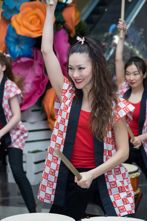 Moscow, Russia - March 5, 2017: group of Japanese Taiko drummers girls perform in Oceania shopping center on the at the opening of a new store UNIQLO Unique Clothing Warehouse.